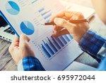 businessman analyzing financial ... | Shutterstock . vector #695972044
