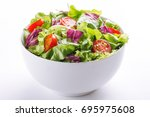 fresh salad in a bowl. healthy... | Shutterstock . vector #695975608