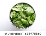 spinach in a bowl. healthy... | Shutterstock . vector #695975860