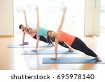 yoga class  group of people... | Shutterstock . vector #695978140