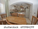 kitchen and dining area in... | Shutterstock . vector #695984299