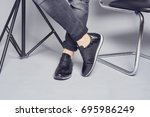 man wearing grey jeans and nice ... | Shutterstock . vector #695986249