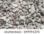 sea pebble stones background | Shutterstock . vector #695991370