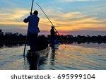 saling in the okavango delta at ... | Shutterstock . vector #695999104