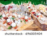 beautifully decorated catering... | Shutterstock . vector #696005404
