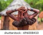 hair style of himba women ...   Shutterstock . vector #696008410