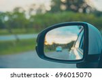 image of wing mirror to  see... | Shutterstock . vector #696015070