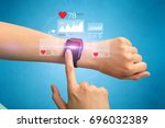 female hand with smartwatch and ... | Shutterstock . vector #696032389