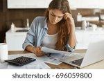 portrait of worried young... | Shutterstock . vector #696059800