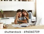 stressed wife and husband with... | Shutterstock . vector #696060709