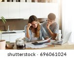 sad family couple realizing her ... | Shutterstock . vector #696061024
