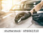 car detailing   man applies...   Shutterstock . vector #696061510
