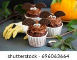 chocolate muffins  with a... | Shutterstock . vector #696063664