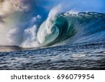 massive blue wave breaks | Shutterstock . vector #696079954