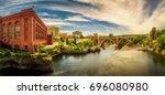 Panoramic cityscape view of Washington Water Power building and the Monroe Street Bridge along the Spokane river, in Spokane, Washington.