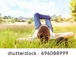 young girl relaxing on grass... | Shutterstock . vector #696088999