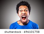 man screaming out loud | Shutterstock . vector #696101758