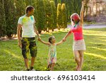 father mother and daughter... | Shutterstock . vector #696103414