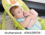 portrait of cute baby boy 6... | Shutterstock . vector #696108934