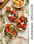 bruschetta with grilled... | Shutterstock . vector #696111130
