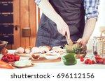 male preparing chicken for...   Shutterstock . vector #696112156