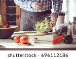 male cooking healthy salad | Shutterstock . vector #696112186