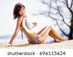 sexy happy girl with a hat... | Shutterstock . vector #696115624