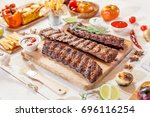 spicy hot grilled spare ribs... | Shutterstock . vector #696116254