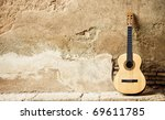 Spanish Guitar On Old Wall ...