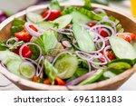vegetable salad bowl on kitchen ... | Shutterstock . vector #696118183
