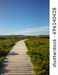 wood pathway newfoundland canada   Shutterstock . vector #696140428