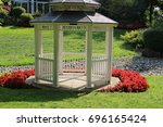 White Gazebo Surrounded By Red...