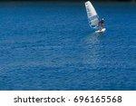 windsurfing is a surface water... | Shutterstock . vector #696165568