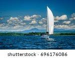 White Sailboat On Lake...
