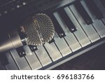 the vocal microphone piano keys | Shutterstock . vector #696183766