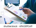 business people shaking hands ... | Shutterstock . vector #696189169