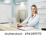 smiling female doctor wearing a ... | Shutterstock . vector #696189970
