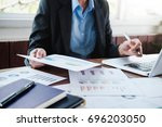 working business people analyse ... | Shutterstock . vector #696203050