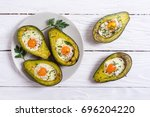 baked avocado with eggs on... | Shutterstock . vector #696204220