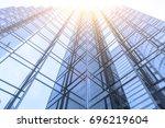 modern office buildings in... | Shutterstock . vector #696219604