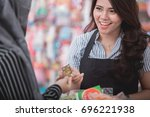 portrait of happy woman paying... | Shutterstock . vector #696221938