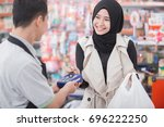 shopping in cashless payments.... | Shutterstock . vector #696222250