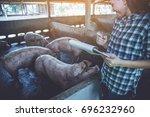 woman farmer working on check... | Shutterstock . vector #696232960