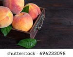 Ripe Peaches In Vintage Wooden...
