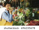 japanese young woman smelling... | Shutterstock . vector #696235678