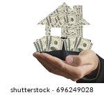 business's hand holds house...   Shutterstock . vector #696249028