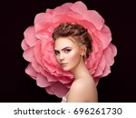 beautiful woman on the... | Shutterstock . vector #696261730