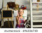 girl with smiling face in front ... | Shutterstock . vector #696336730