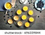 Small photo of Cooling rack with delicious crispy tarts on table