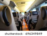 the seat inside the bus. blur... | Shutterstock . vector #696349849